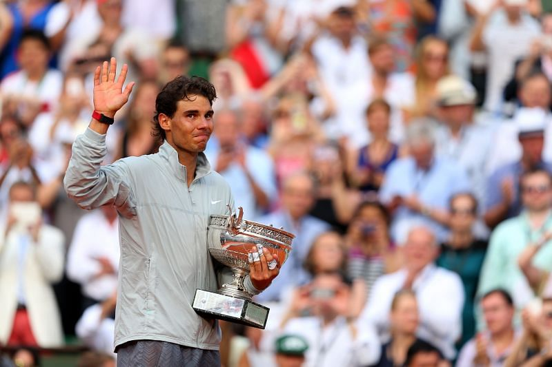 Rafael Nadal with the French Open title in 2014 when he defeated Novak Djokovic in the final