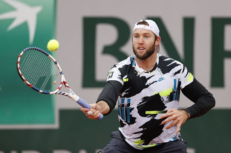 Jack Sock hits a volley