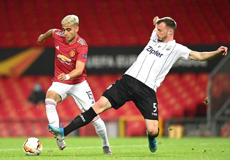 Pereira (left) in action for Manchester United