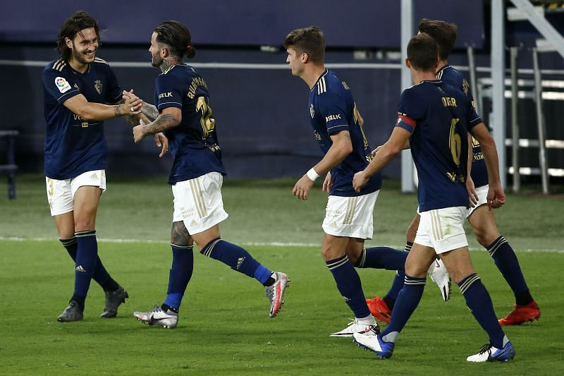 Ruben Garica celebrates with his teammates after scoring his side