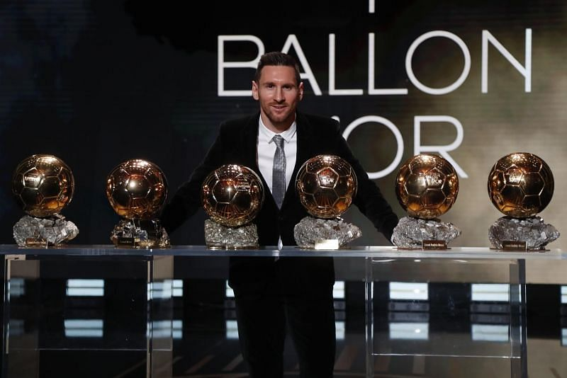 Lionel Messi posing with his six Ballon d
