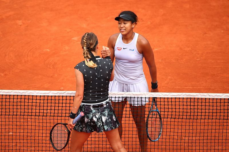 Naomi Osaka and Victoria Azarenka shake hands after their match at the 2019 French Open