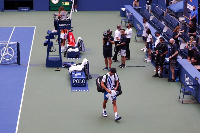 Novak Djokovic leaving the court after being disqualified.