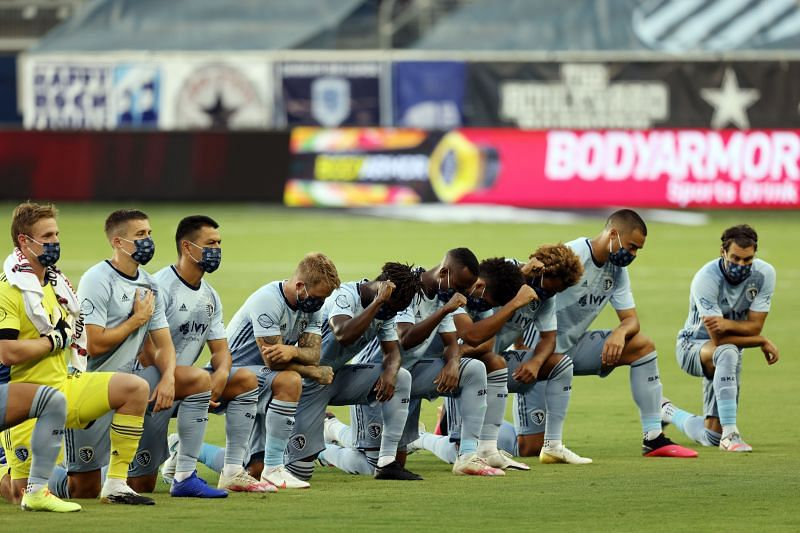 Sporting KC players kneel during the National Anthem in support of the Black Lives Matter movement