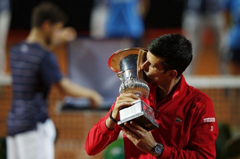 Novak Djokovic celebrates with his trophy after winning the Internazionali BNL d