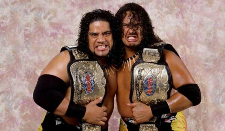 Fatu and Samu with the WWF Tag Team Championship belts