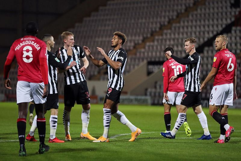 Struggling Newcastle United striker Joelinton scored twice in the 7-0 thrashing of Morecambe in the League Cup