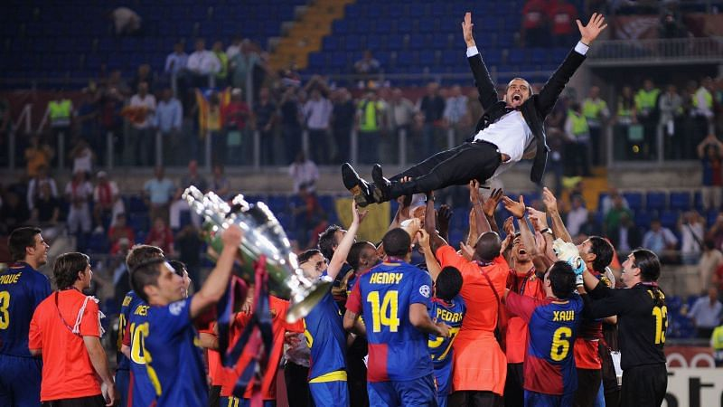 Pep Guardiola is air-borne after winning the 2008-09 Champions League.