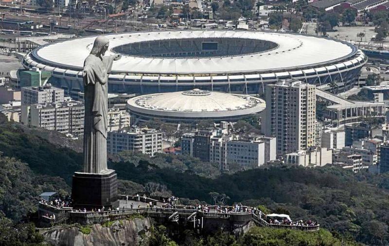 Christ the Redeemer statue overlooks the imposing Maracana Stadium in Rio de Janeiro.