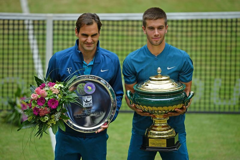 Borna Coric poses with the 2018 Halle Open trophy