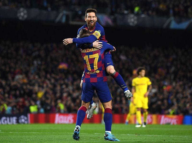Antoine Griezmann of FC Barcelona celebrates with teammate Lionel Messi