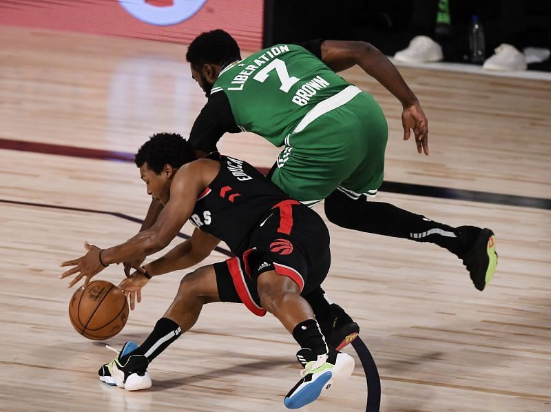Brown and Lowry battle for possession