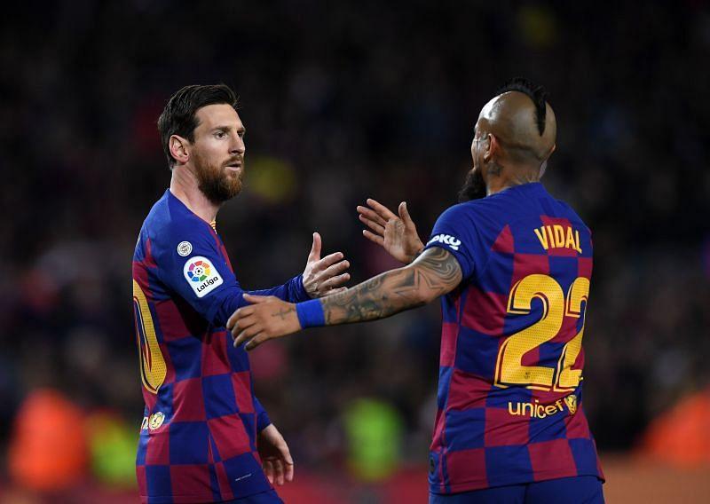 Lionel Messi and Arturo Vidal