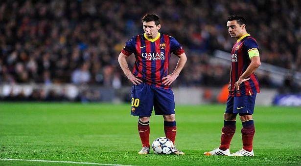 Xavi (left) and Lionel Messi