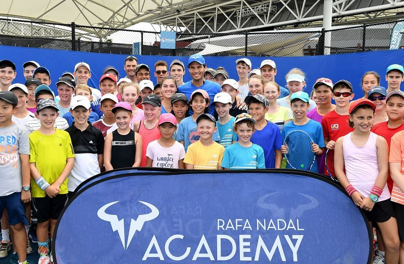 Rafael Nadal with some of his Academy students.