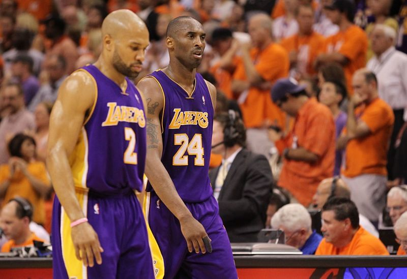 Derek Fisher alongside Kobe Bryant