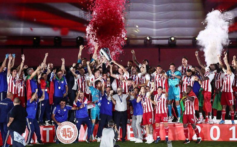 Olympiacos celebrate their 45th Greek title last season.