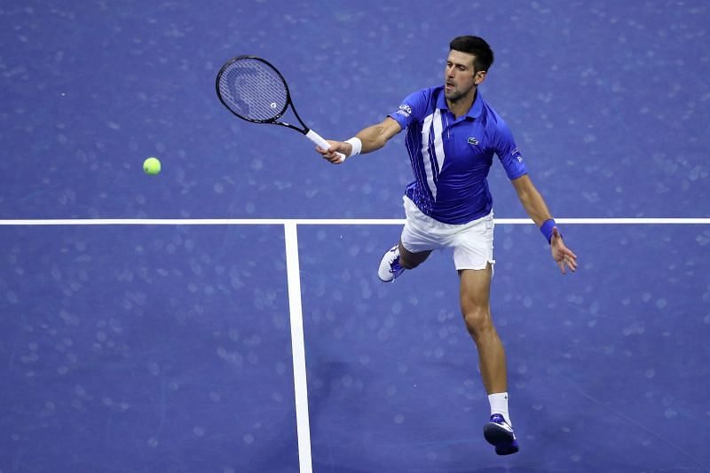 Novak Djokovic plays a volley at 2020 US Open