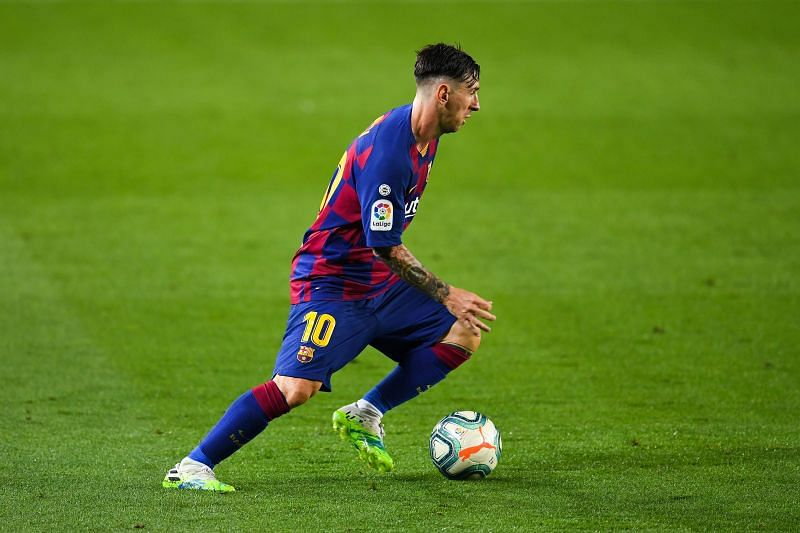 Lionel Messi of FC Barcelona runs with the ball