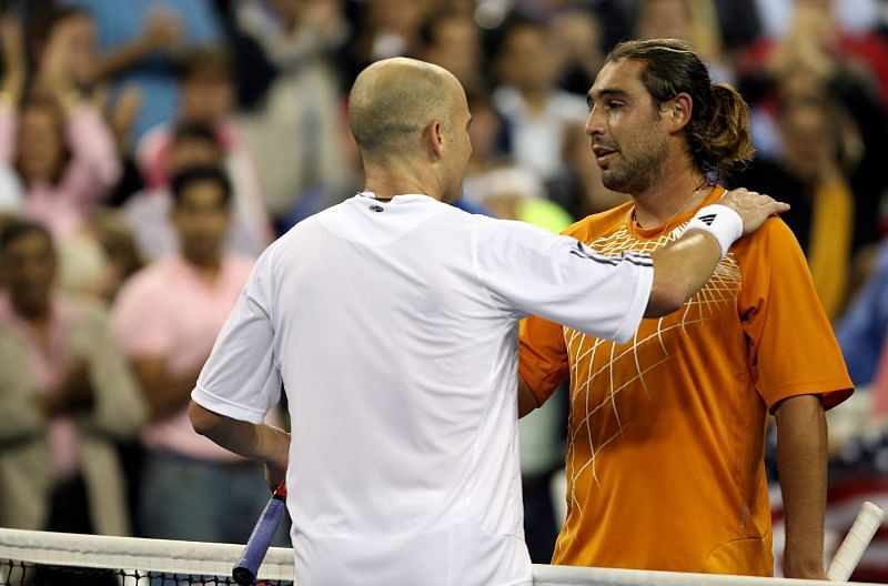 Andre Agassi (L) and Marcos Baghdatis (R) at the 2006 US Open