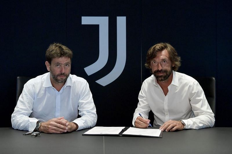 Andrea Pirlo (right) being unveiled as the new Juventus manager