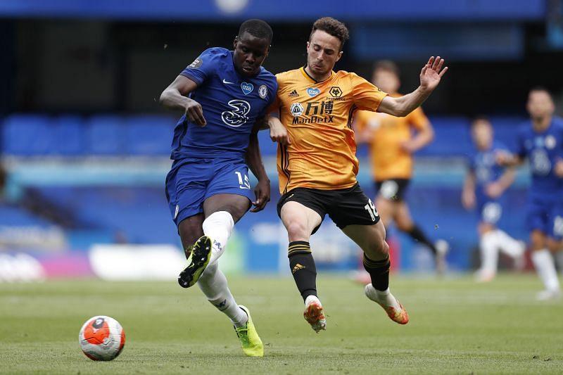 Kurt Zouma battles for possession against Wolves.