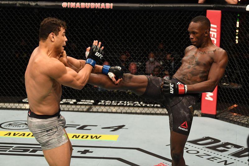 Israel Adesanya kicks Paulo Costa during their middleweight championship bout