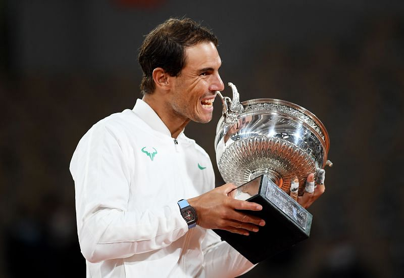 Rafael Nadal of Spain bites the trophy following victory at the 2020 French Open