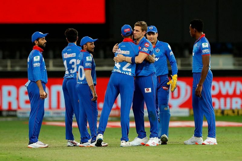 Delhi Capitals players celebrate the fall of a wicket.