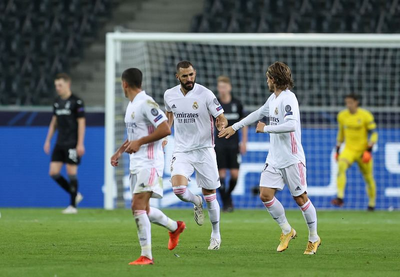Karim Benzema scored the first of two late Real Madrid goals