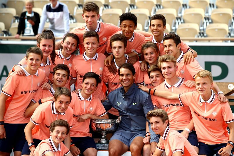 Rafael Nadal celebrates victory with the ball boys following his 2019 French Open title