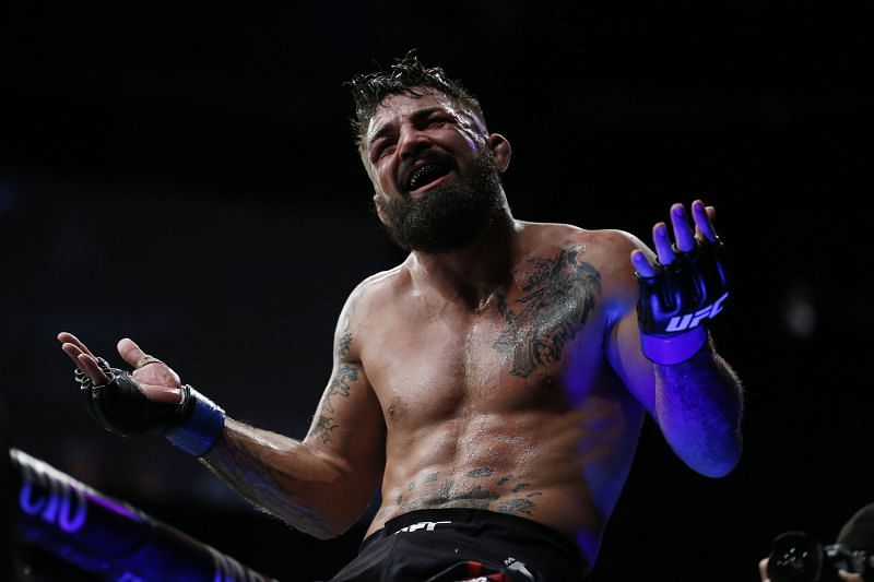 Mike Perry celebrates after defeating Alex Oliveira of Brazil