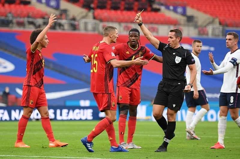 Thomas Meunier is shown a yellow card for bringing down Henderson inside the area
