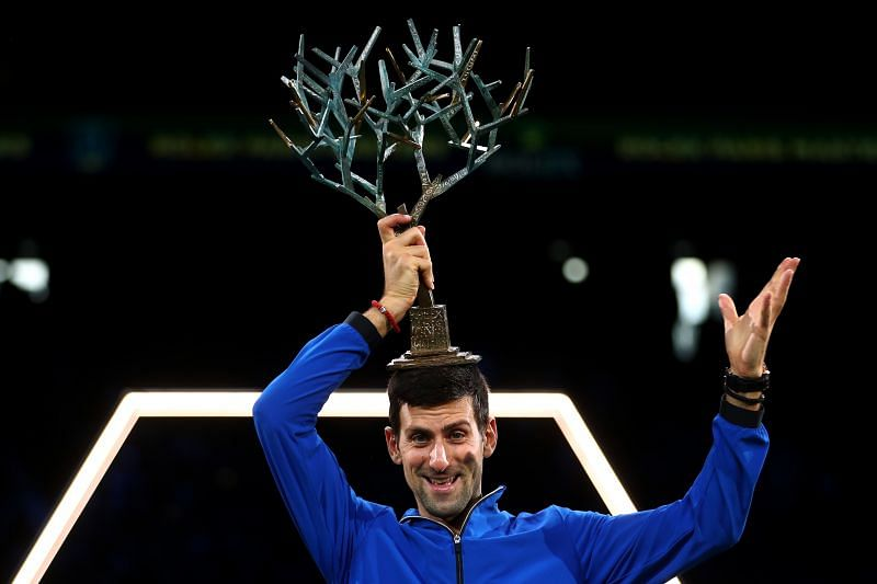 Novak Djokovic celebrates with the trophy after winning the Rolex Paris Masters last year