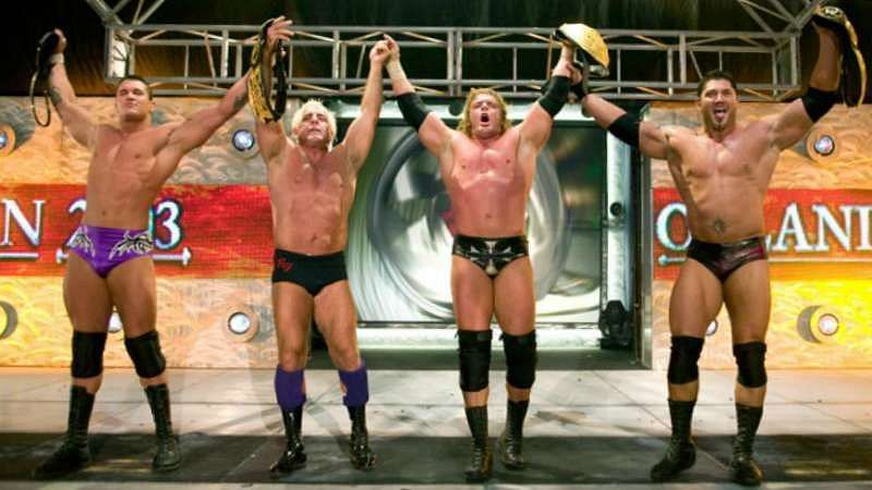 Left to right: Randy Orton, Ric Flair, Triple H, Batista