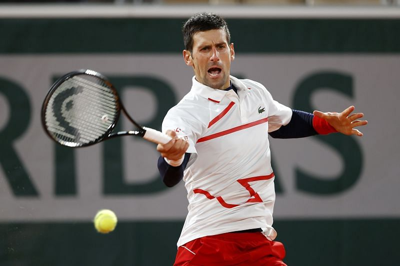 Novak Djokovic plays a forehand during his match against Pablo Carreno Busta t the 2020 French Open