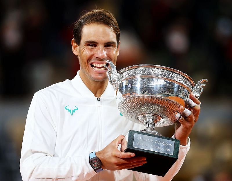 Rafael Nadal poses with the trophy after beating Novak Djokovic to win his 13th Roland Garros title