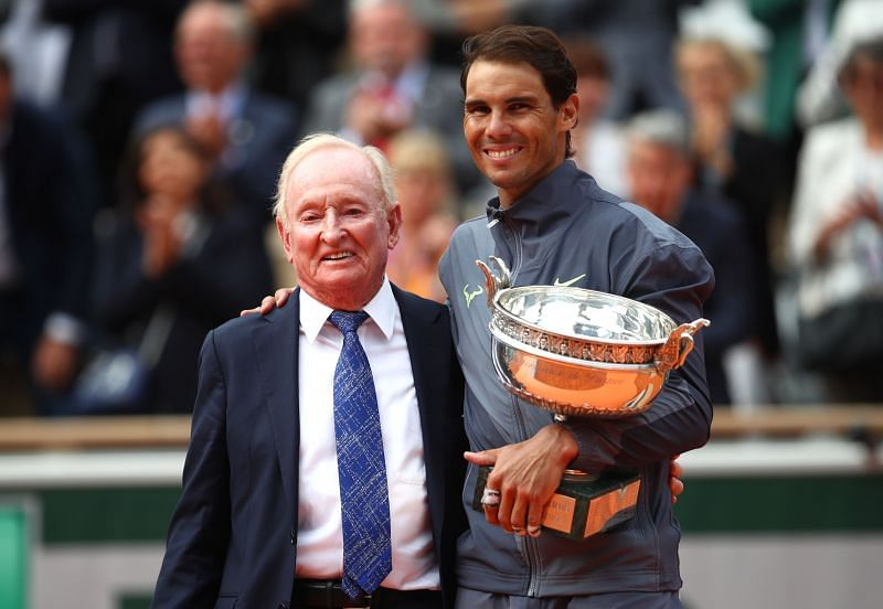 Rafael Nadal of Spain collects the trophy from Rod Laver at the 2019 French Open at Roland Garros
