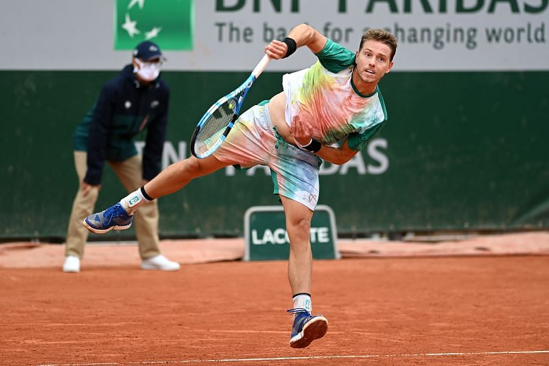 James Duckworth serves during his first round match against Tommy Paul at the 2020 French Open