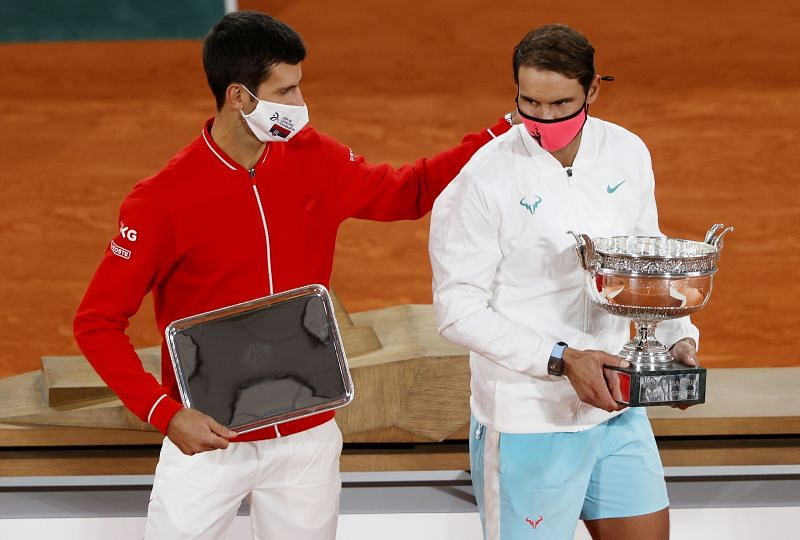 Runner-up Novak Djokovic and winner Rafael Nadal with their respective trophies following the Men