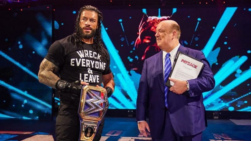 Roman Reigns with Paul Heyman and the WWE Universal Championship