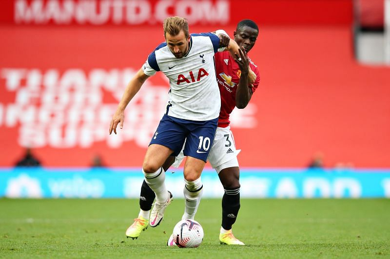Eric Bailly tussling with Harry Kane for possession