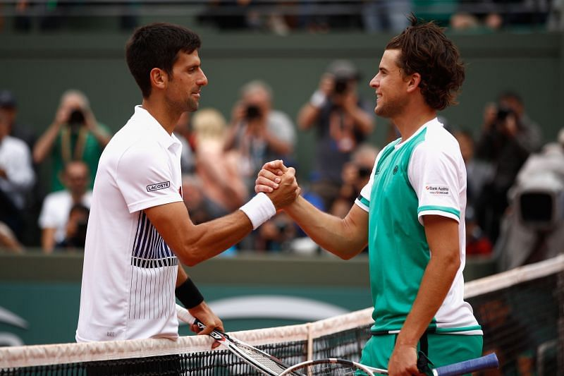 Novak Djokovic and Dominic Thiem greet each other at the net ATP Masters Series Madrid