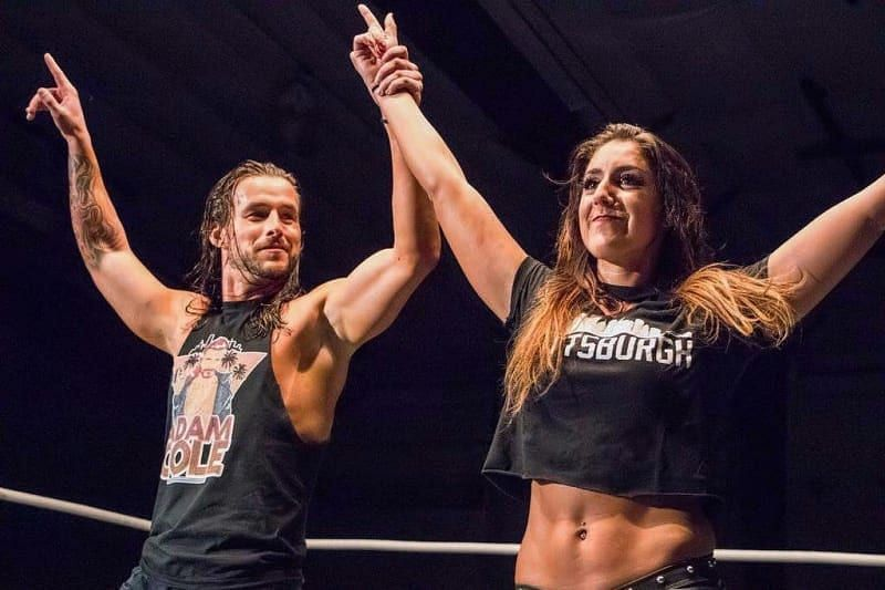 Britt Baker and Adam Cole are partners in real-life but are on opposing promotions, with Britt Baker a part of AEW and Adam Cole one of the top stars in WWE NXT