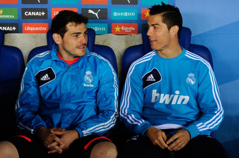 Iker Casillas sits with Cristiano Ronaldo on the Real Madrid bench