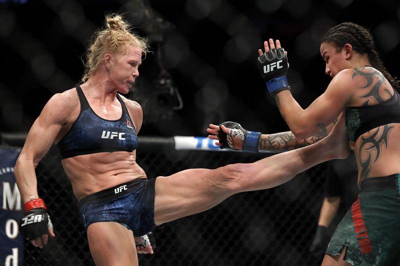 Holly Holm (L) kicks Raquel Pennington in bantamweight bout during UFC 246