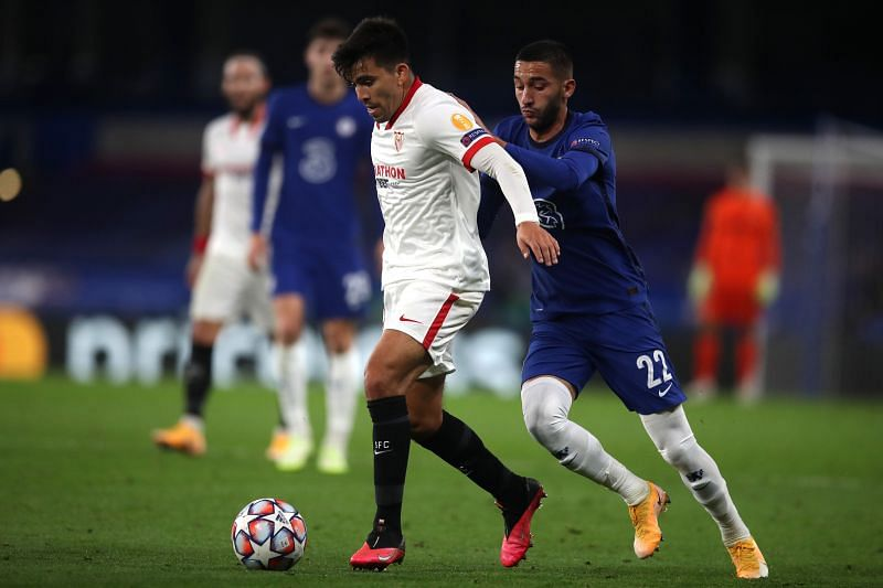 Marcos Acuna of FC Sevilla is challenged by Hakim Ziyech of Chelsea