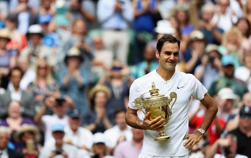 Roger Federer celebrates with the Wimbledon trophy following his victory in the 2017 final.