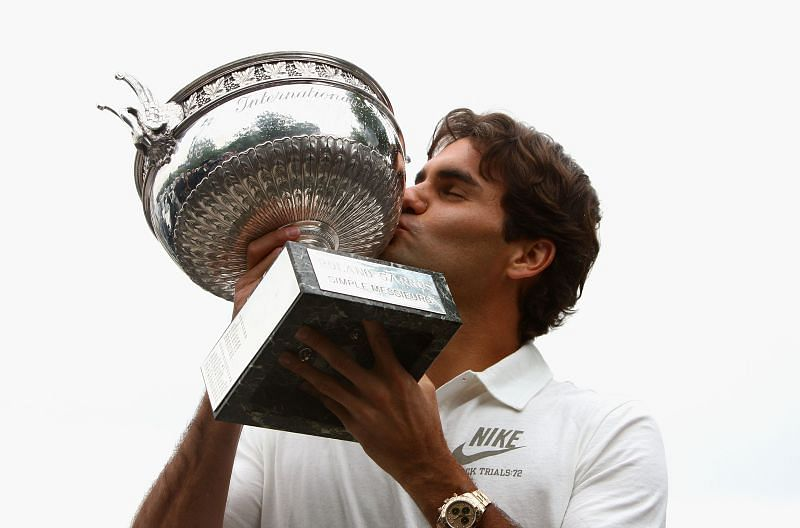 Roger Federer of Switzerland with the French Open winners trophy in June 2009