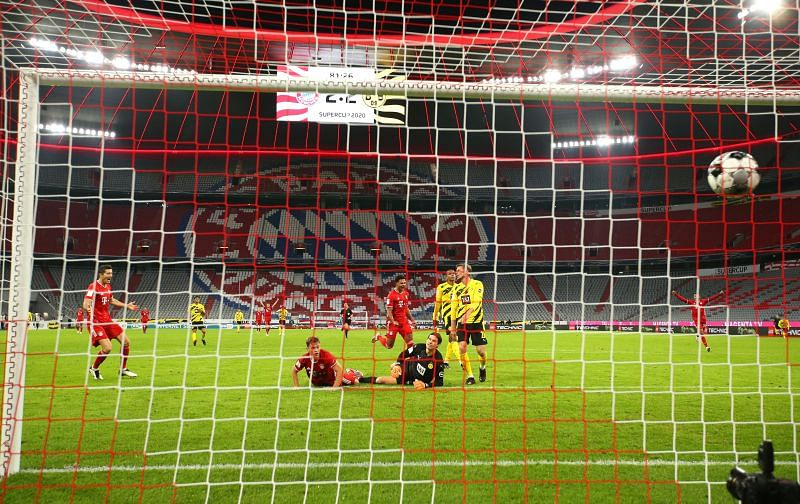 Joshua Kimmich of FC Bayern Munich scores his sides third goal in the 82nd minute.